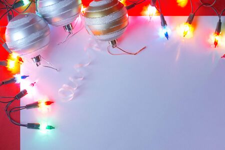 New Christmas baubles border with holiday lights with a white background and copy space. Stock Photo - 6053027