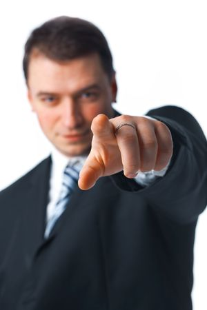 Close up portrait of young confident business man pointing to you isolated on white background