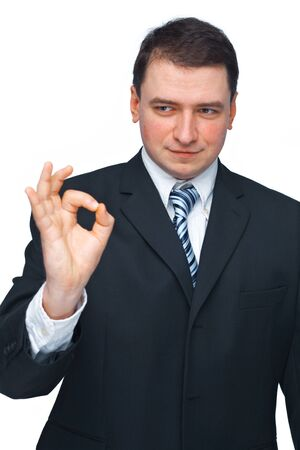 Young businessman making an ok sign with his fingers over white background  photo