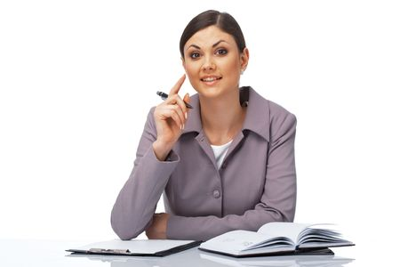 Portrait of a young attentive businesswoman with a pen and dairy over white. photo