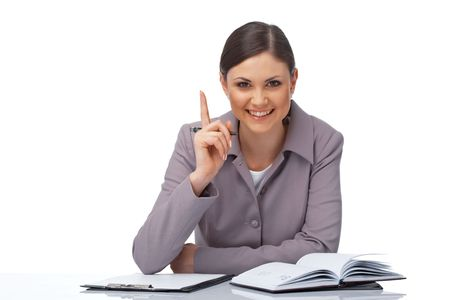 Portrait of a young businesswoman pointing her finger with clipboard, pe and diary over white photo