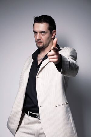Portrait of a young confident man pointing at you  over white. photo