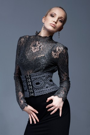 Portrait of a beautiful model in black, lace blouse, posing. Stock Photo