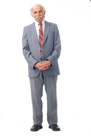 Full length portrait of an elder man standing over white.