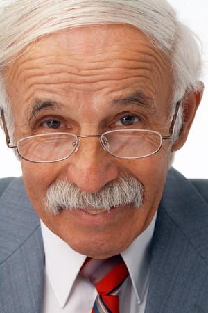 joyfull: Close-up portrait of a happy elder businessman in the glasses.