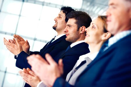 Colleagues applauding during a business meeting in the office. Stock Photo - 7225149