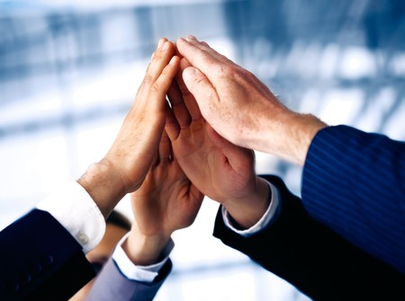Hand of the business people forming a pyramid in the air. Stock Photo - 7234910