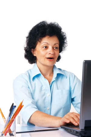 Elder surprised woman using laptop on white background. photo