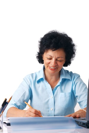 Elder woman writing something with a pencil photo