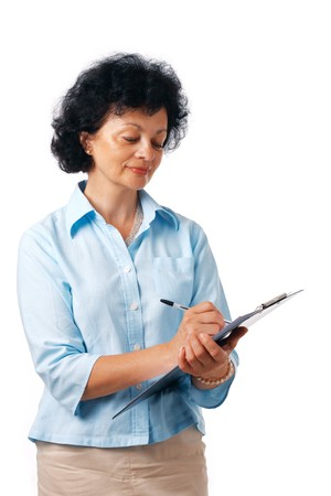 Portrait of a mature woman taking notes over white background