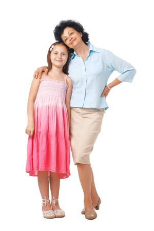 A full length portrait of grandmother embracing her grand daughter. Stock Photo - 7765052