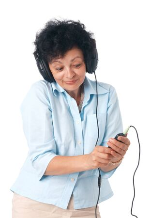 Elder happy woman with phones and mobile listening something. photo