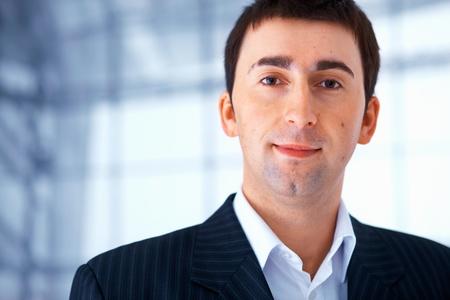 pleasant: Portrait of a young pleasant man in black striped suit.