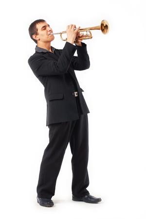 m�sico: Retrato de un joven jugando su trompeta Foto de archivo