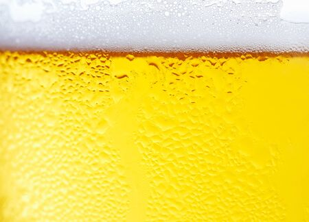 Fresh  beer with froth and condensed water pearls