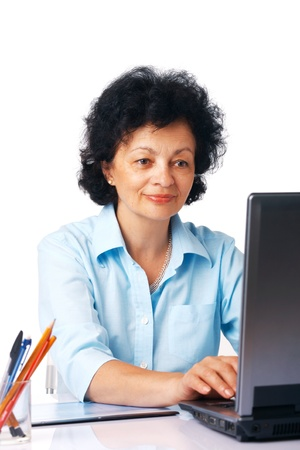 Elder woman using laptop on white background. photo