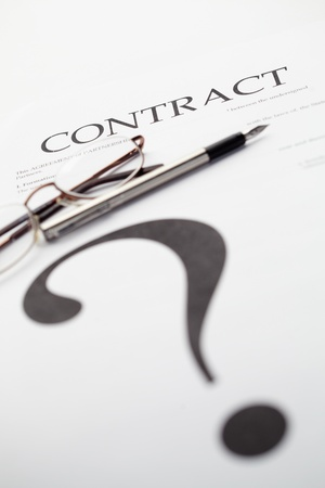 whose: question mark on paper with contract