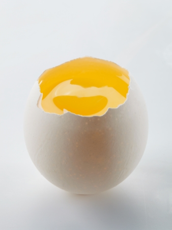 Fresh and natural egg yolk with the shell  Stock Photo