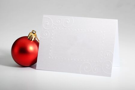 christmas tag: Red Christmas ornament with greetings card
