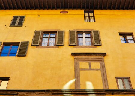 florentine: Florentine building facade with different windows Stock Photo
