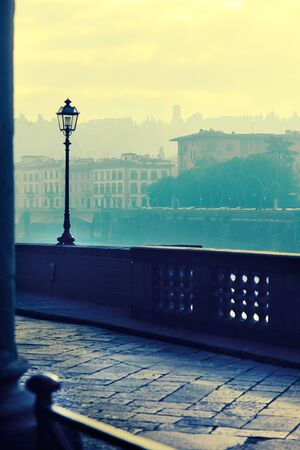 executed: View of the embankment morning in Florence .Photo executed in a range of cross processing