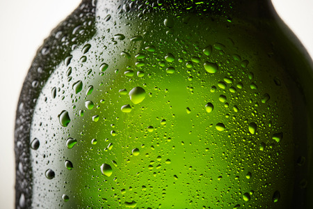 alcohol bottles: Close up drops of a ice cold bottle of Beer