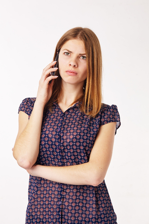 dissapointed: Young woman talking on the phone, sad and dissapointed. Stock Photo