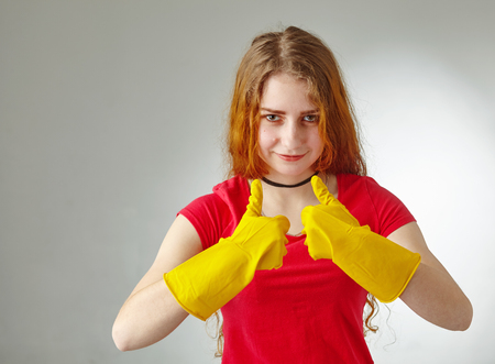 girl with gloves showing pointing up Standard-Bild