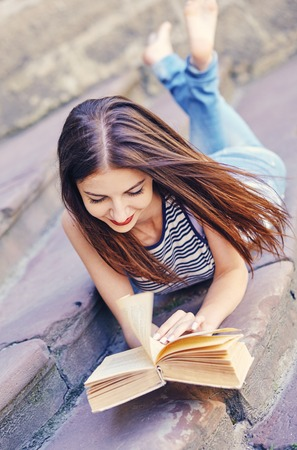 girl studying and reading a book. Relax, rest, education concept, recreation .