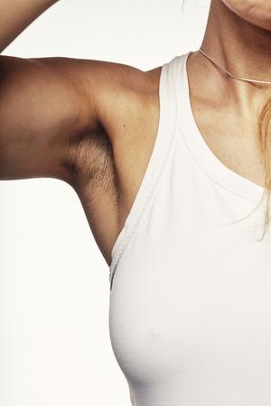 young woman demonstrates under the armpit Zdjęcie Seryjne