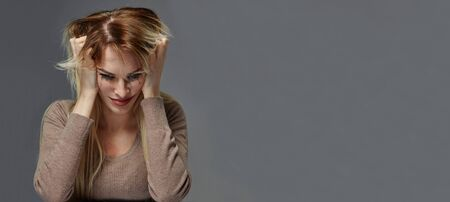 woman suffering from stress or headache while being offended by pain, Reklamní fotografie - 134977883