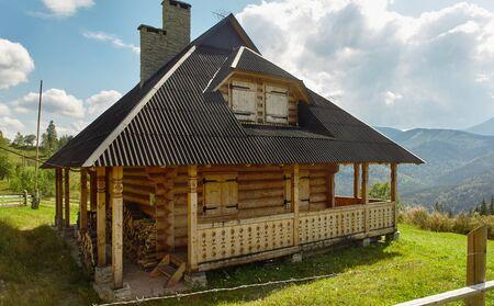 modern wooden Hutsul-style house in Dzembronya village in Ukrainian Carpathians