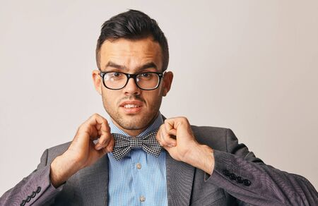 man with glasses and with butterfly tries to emphasize his style