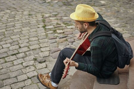 Lovely young street musician with guitar