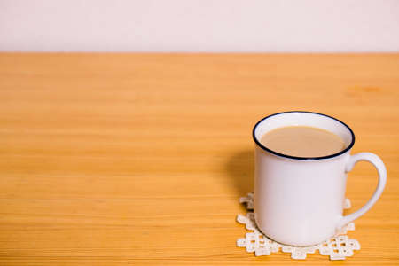 White cup placed on the table