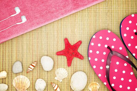straw mat: Girlish Summer Accessories on a Straw Beach Mat Decorated with Seashells Stock Photo