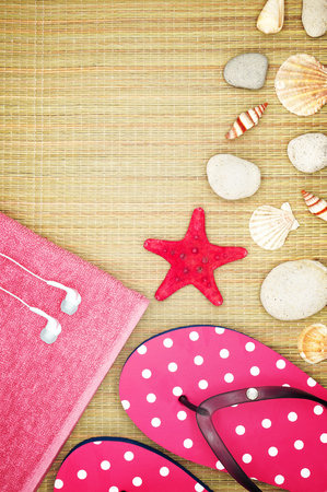 beach mat: Girlish Summer Accessories on a Straw Beach Mat Decorated with Seashells Stock Photo