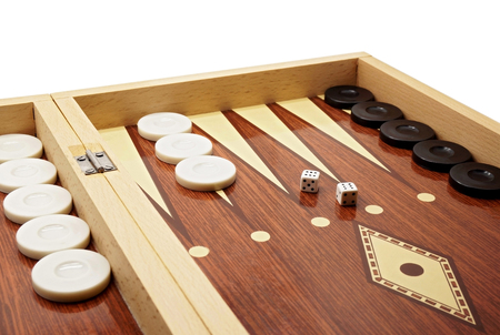Backgammon Game Board with Black and White Pieces and Dice Stock Photo