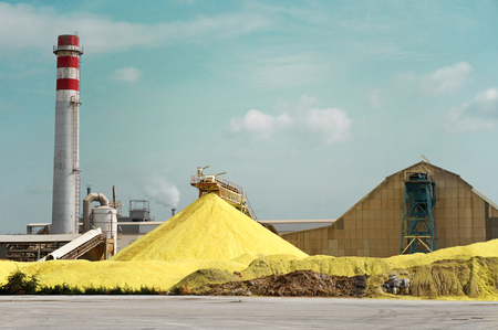 refinement: Sulfur Factory  A Yellow Pile of Sulfur Produced in an Industrial Facility Stock Photo