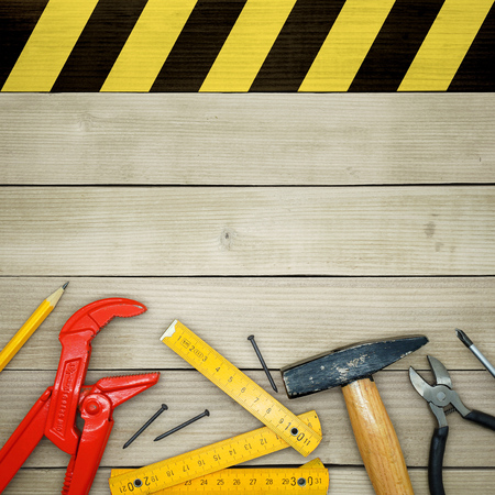 do it yourself: Under Construction - Do It Yourself - Handyman Tools on a Wooden Background