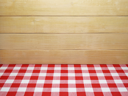 tablecloth: Red Checkered Tablecloth and Wooden Planks Background Stock Photo
