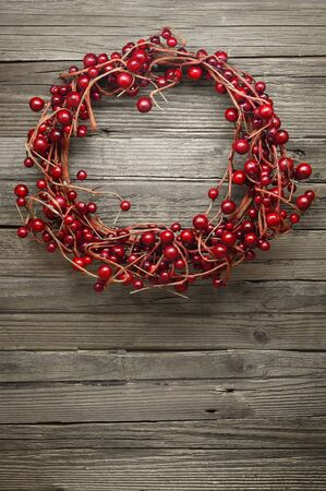 winterberry: Winterberry Wreath on a Wooden Rustic Background