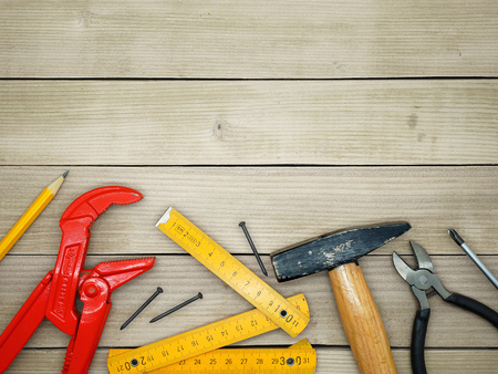 handyman tools: Under Construction - Do It Yourself - Handyman Tools on a Wooden Background