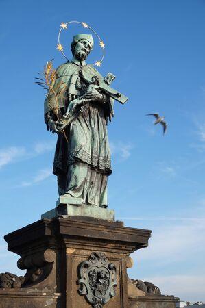verdigris: Statue of Saint John of Nepomuk at the Charles Bridge in Prague