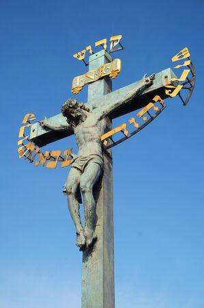 verdigris: Statue of the Crucifixion of Jesus Christ at the Charles Bridge in Prague