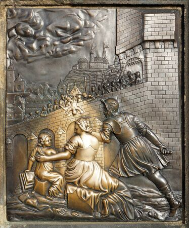 verdigris: Bronze Bas-Relief Sculpture on the Pedestal of the Statue of St. John of Nepomuk at the Charles Bridge in Prague depicting the Execution of the Saint