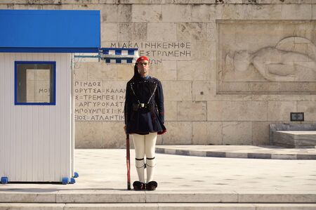 tsolias: ATHENS, GREECE - December 17, 2015 - Presidential Guard Standing at Attention in front of the Tomb of the Unknown Soldier at the Greek Parliament in Athens.