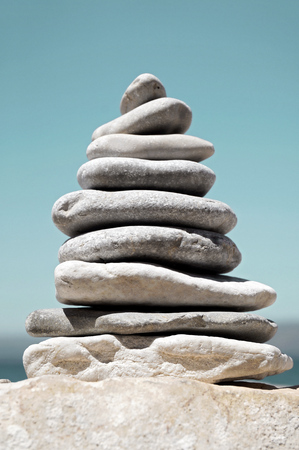hierarchy: Stack of Sea Pebbles in the Shape of Tree or Pyramid Stock Photo