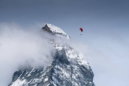 Paragliding over Matterhorn in the Swiss Alps