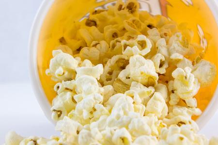 fresh pop corn: close up popcorn in a bucket orange